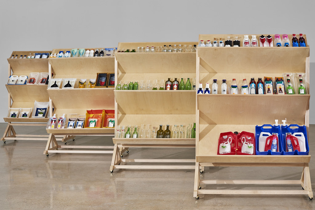 wooden shelves filled with plastic objects