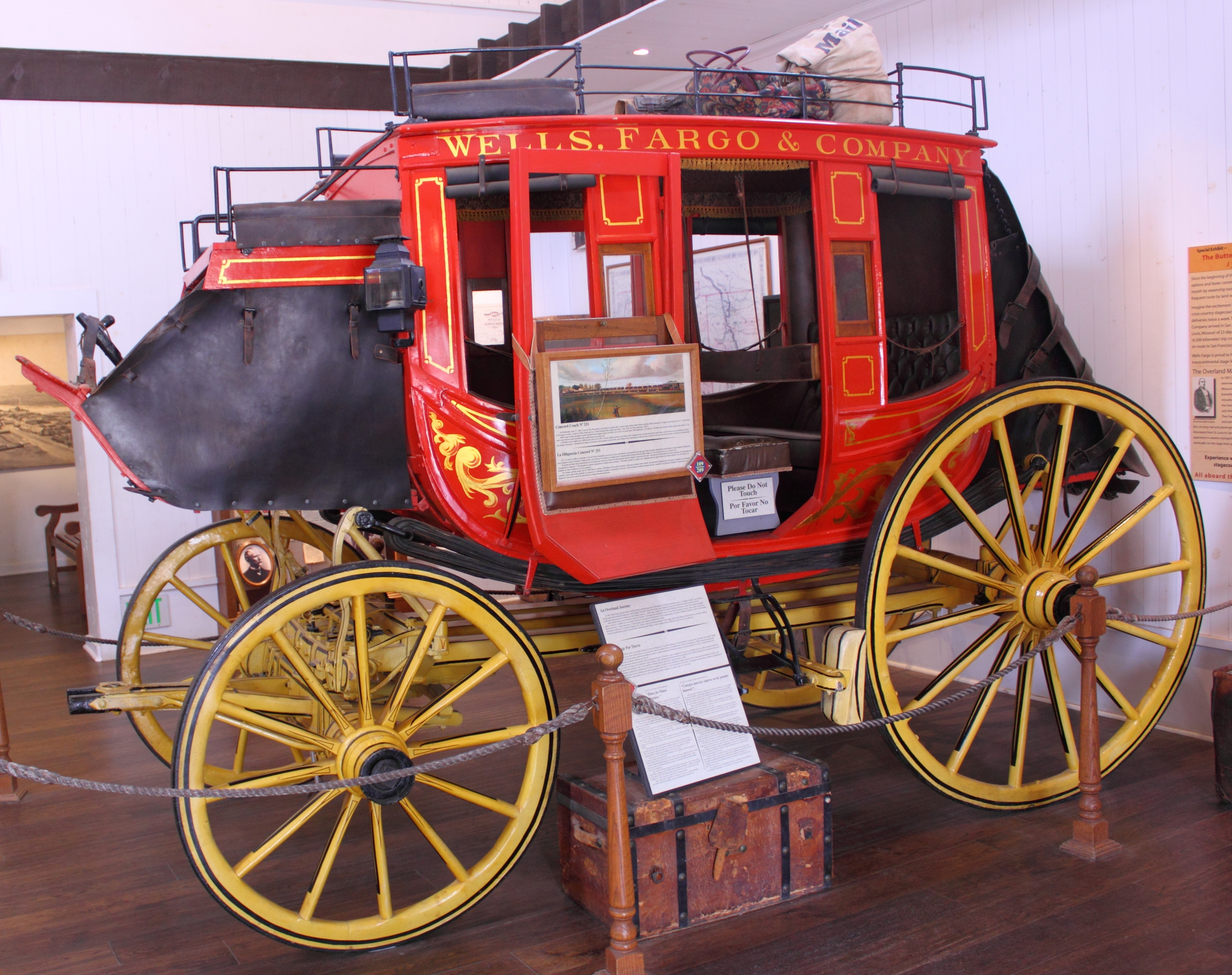 Concord stagecoach No. 251 in Wells Fargo livery. Front and back boots have leather covers. Displayed at the Seeley Stable Museum, Old Town San Diego, California. Photo taken on April 26, 2010.