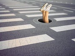 Texting Teen Falls Down Manhole