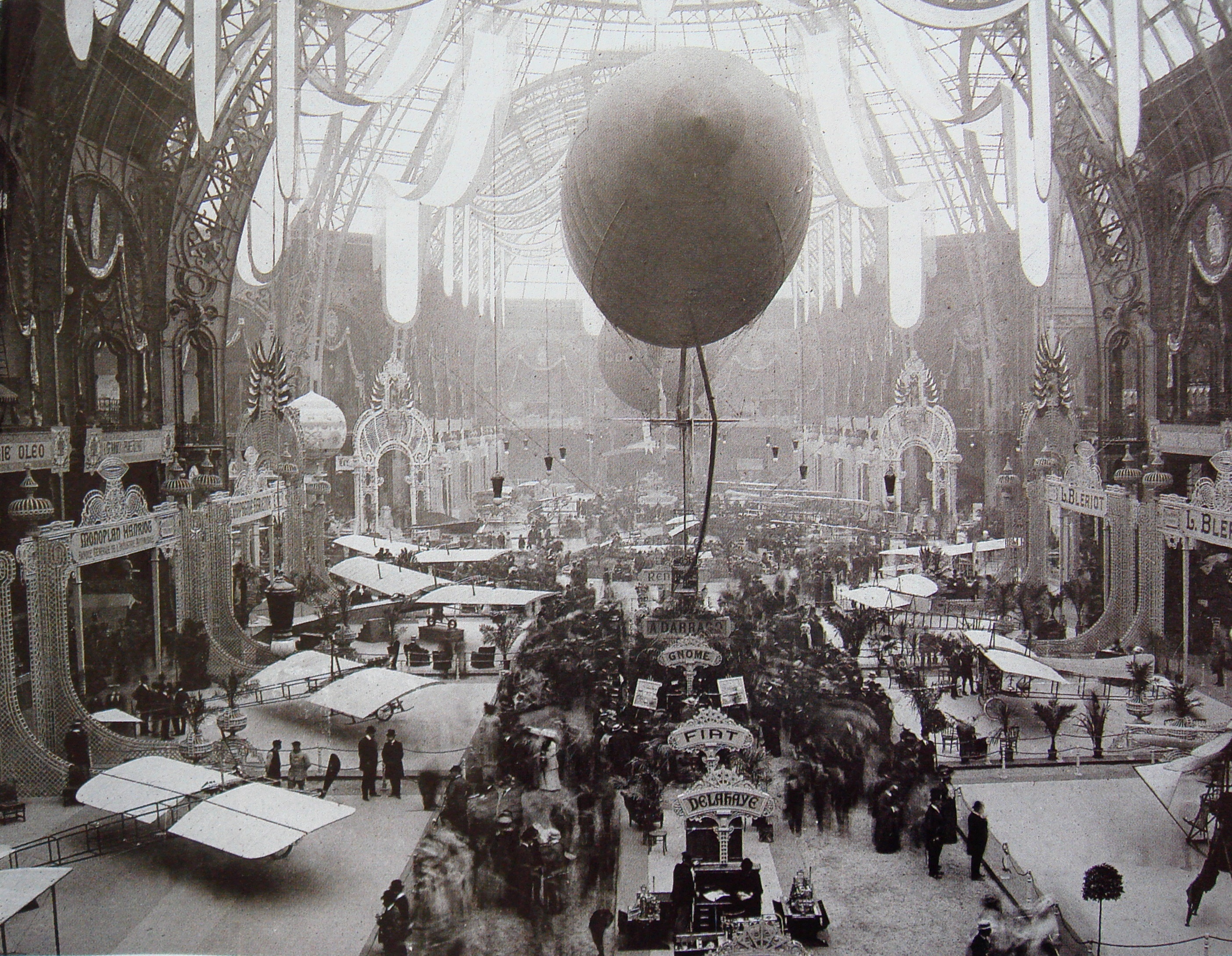 Salon de locomotion aerienne 1909 (precursor to the Paris Air Show) in the Grand Palais, Paris. E.xhibits include: Monoplan Hanriot; Louis Blériot; Delahaye; Fiat; Gnome; Darracq.