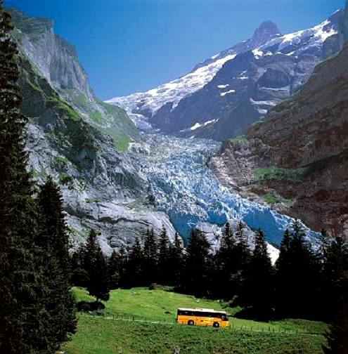 Swiss post bus in the Bernese Alps near Gridelwald. Photo taken on September 24, 2002.