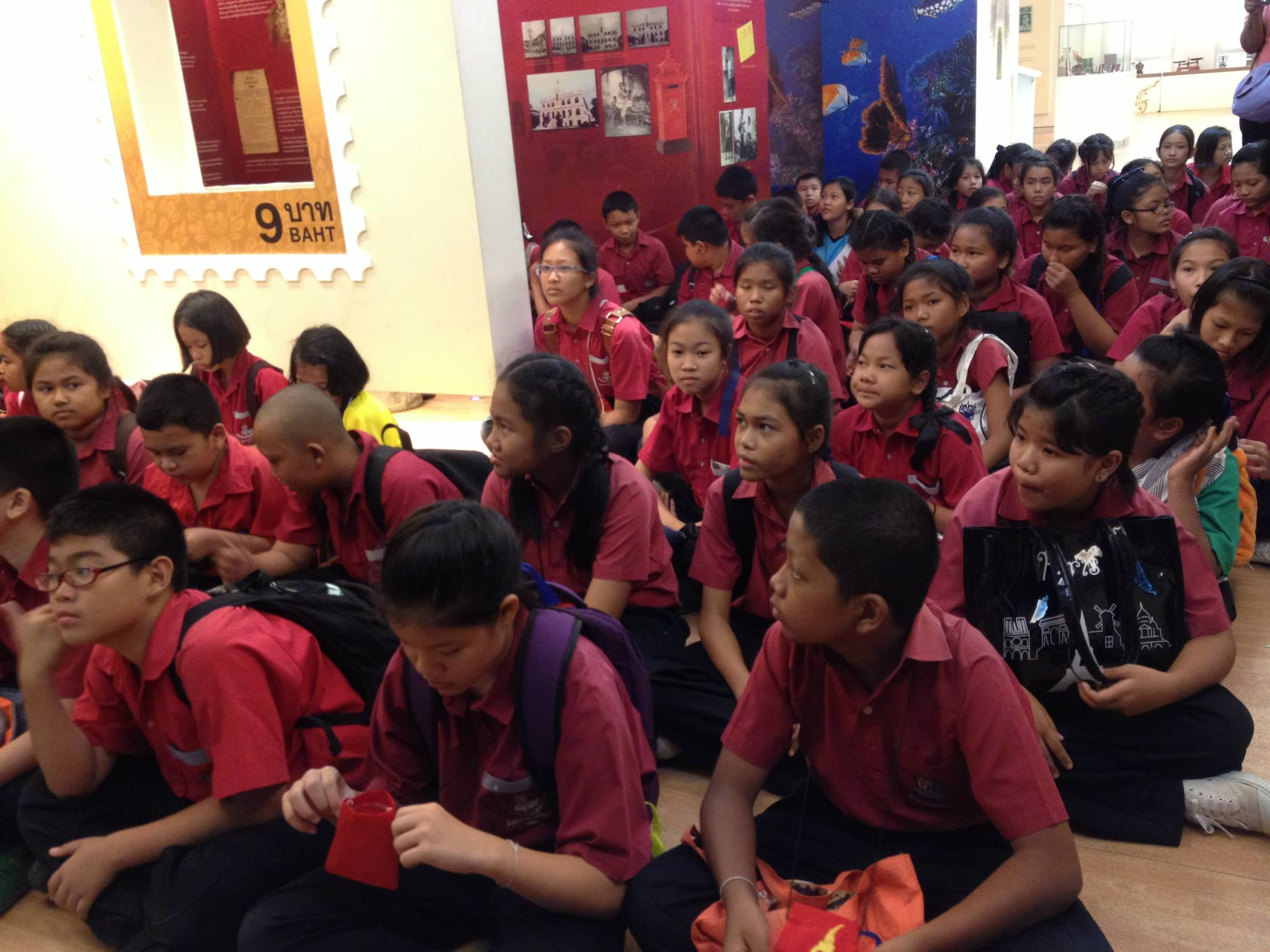 Thai kids learning about stamps during a fieldtrip to Sam Sen Nai Philatelic Museum in Bangkok. Photo taken in August 2013.
