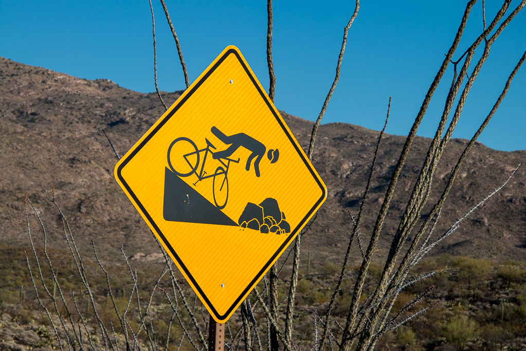 Falling off bicycle warning sign