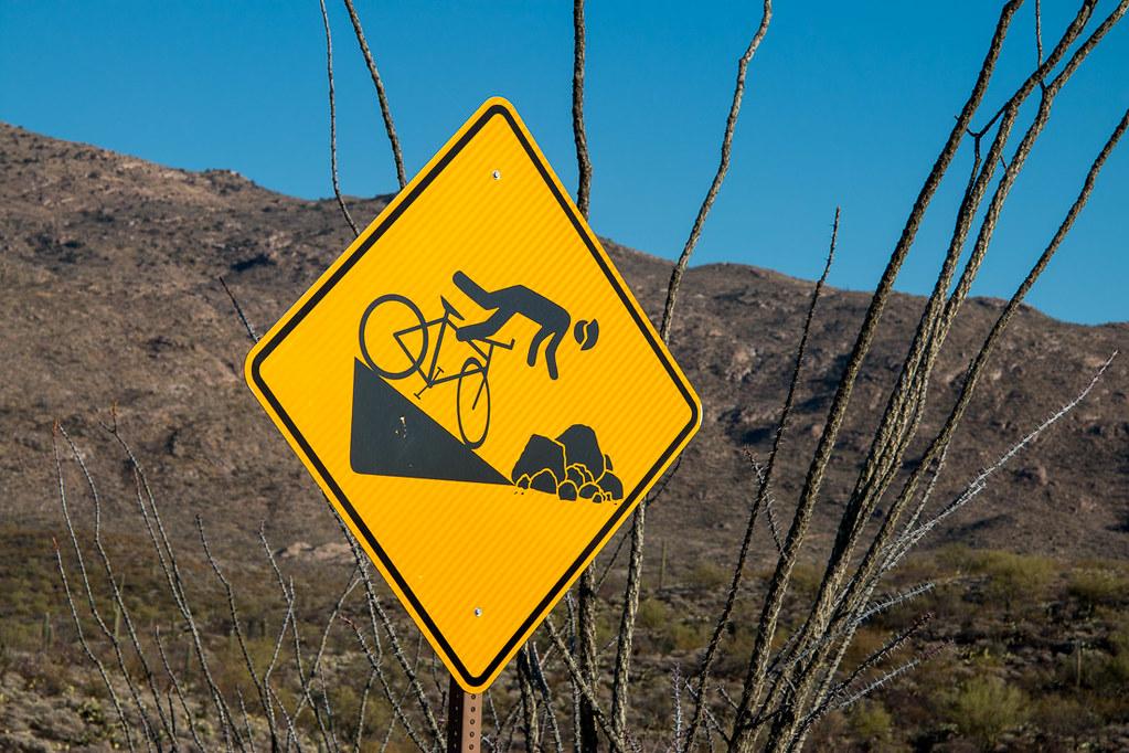 Falling off bicycle warning sign