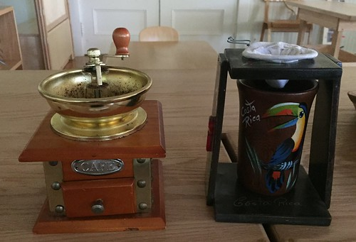 coffee grinder and filter with cup from Costa Rica