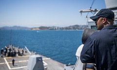 Chief Fire Controlman Ryan Patricio stands lookout watch as USS Michael Murphy (DDG 112) arrives in Port Moresby. (U.S. Navy/MC2 Justin Pacheco)