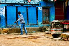 Man sweeping the street in Bhaktapur Nepal