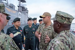 Capt. Rich LeBron, commanding officer of USS Bonhomme Richard (LHD 6), describes flight deck capabilities to Gen. Park Han-ki during a ship's tour, Oct. 23. (U.S. Navy/MC3 Gavin Shields)