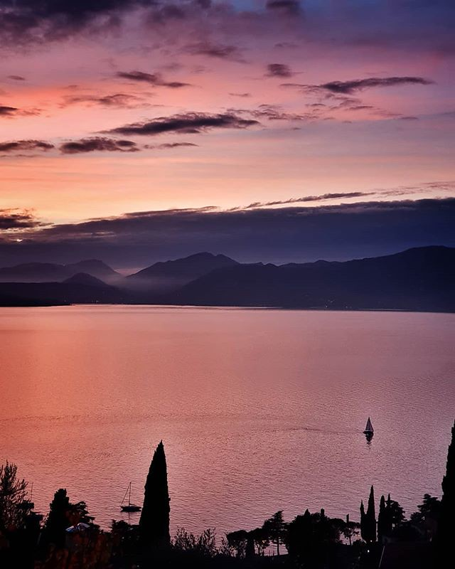 Sunset @ garda lake #sunset #lake #gardasee #garda #violet #clouds #cloudy #sky #landscape #boat #sailing #landscape #view #photooftheday #picoftheday #igersitalia #igers #igersgarda #beautiful #life #family #mountains
