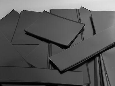 Strips of Hawid brand black stamp mounts