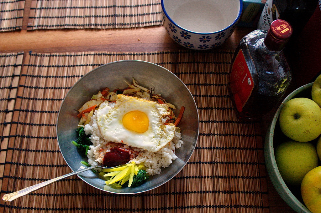 homemade bibimbap (rice with some cooked, marinated and raw veggies, hot and spicy Korean chili pepper paste, and fried egg)