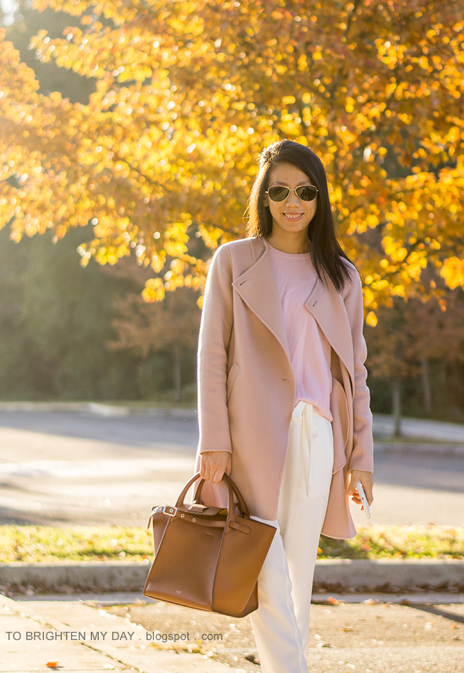 pink wool open front draped jacket, pink cashmere sweater, white crepe ankle pants, brown tote