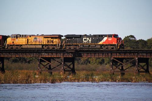CN 2857 leads the UP OSVVP-03 EB oil train over Buffalo Lake