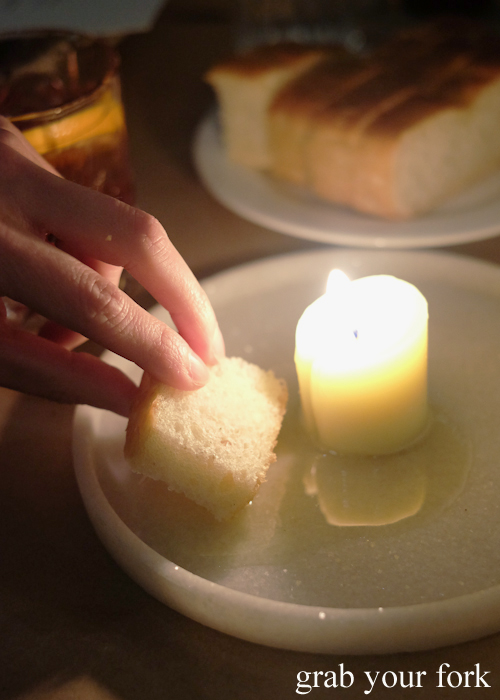 Dipping the foacaccia into melted beef dripping candles at Bistecca Sydney
