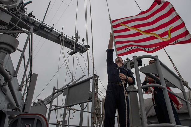 PACIFIC OCEAN (Oct. 17, 2018) Quartermaster 3rd Class Bradley Kobernik, left, from Jefferson, Ohio, and Quartermaster 3rd Class Danaril Mojet, from Dallas, raise the First Navy Jack aboard the aircraft carrier USS John C. Stennis (CVN 74). John C. Stennis is underway conducting routine operations in the U.S. 3rd Fleet area of operations. (U.S. Navy photo by Mass Communication Specialist Seaman Joshua L. Leonard)