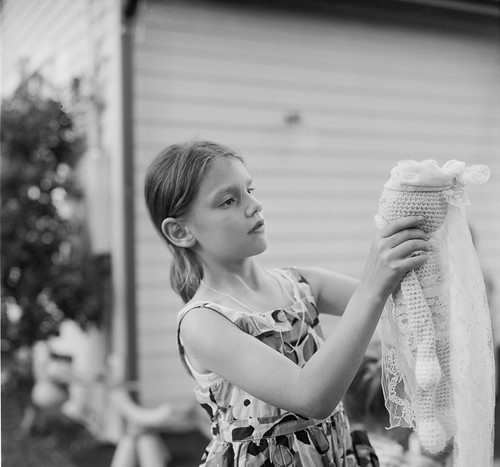 A girl with a knitted doll
