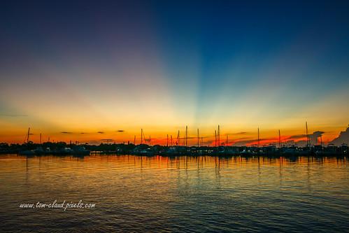 sun sunrise sky weather nature mothernature outdoors water marina boats dock reflect reflection river saintlucieriver seascape stuart florida usa horizon