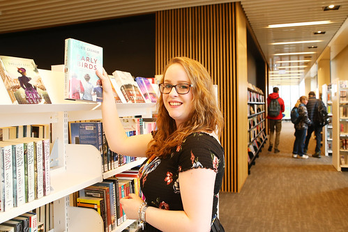 Staff member at the fiction shelves