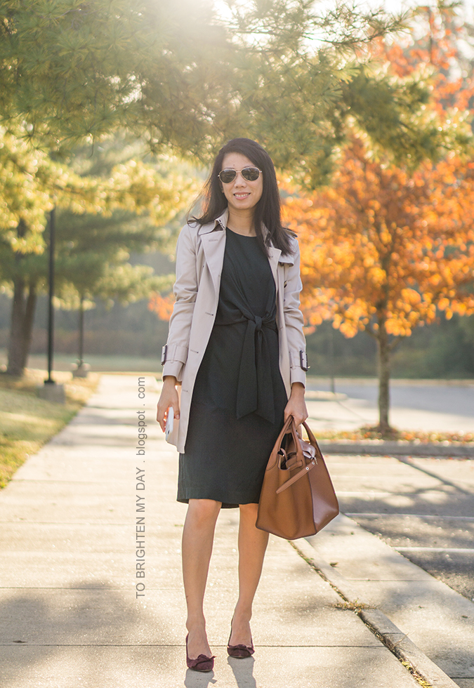 trench coat, hunter green tie front dress, brown tote with belt, berry suede pumps with bow