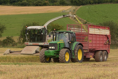 Claas Jaguar 900 SPFH filling a Herron Trailer drawn by a John Deere 6930 Tractor