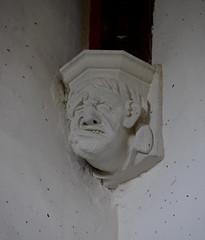 grim-faced corbel gurning miserably (19th Century)