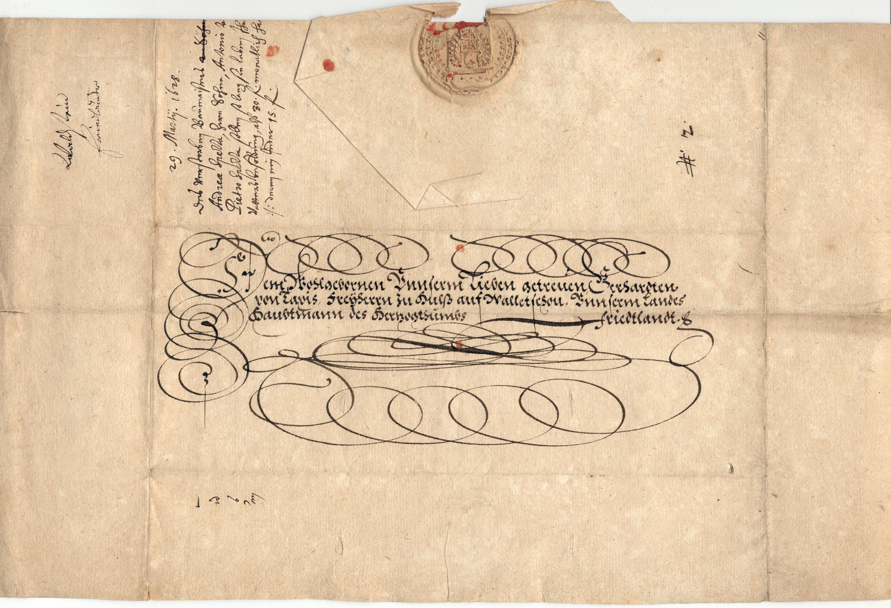 An opened lettersheet sent in 1628 from Generalissimo Wallenstein to his chancellor concerning the continuation of the salary of his deceased builder to his sons. The outside of the lettersheet shows folds, address, and the seal of Wallenstein. The letter was written on the obverse side.
