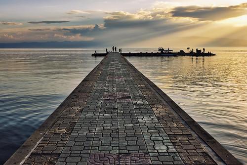 lake clouds sun sunset sunrays silhouettes people golden path landscape outdoors ohrid macedonia europe travel nikon nikond750 nikkor283003556 gazzda hrvojesimich