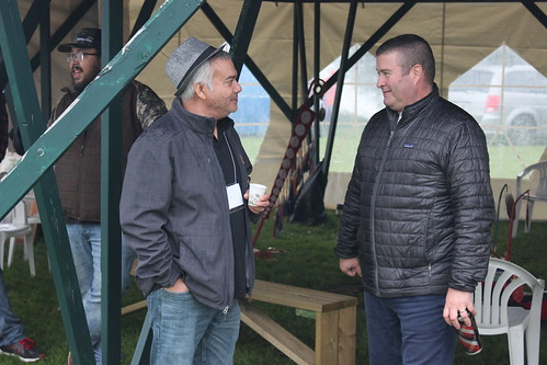 <p>A Confederation College student and Seven Generations CEO Brent Tookenay talk at Fall Harvest</p>